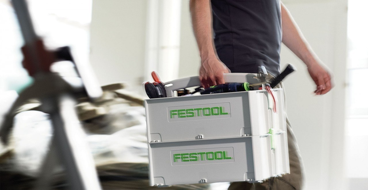 Man carrying Festool tools in toolbox-1